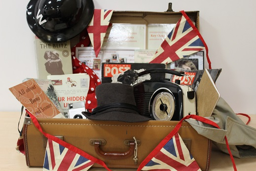 Vintage suitcase full of props relating to Mass Observation and the Second World War